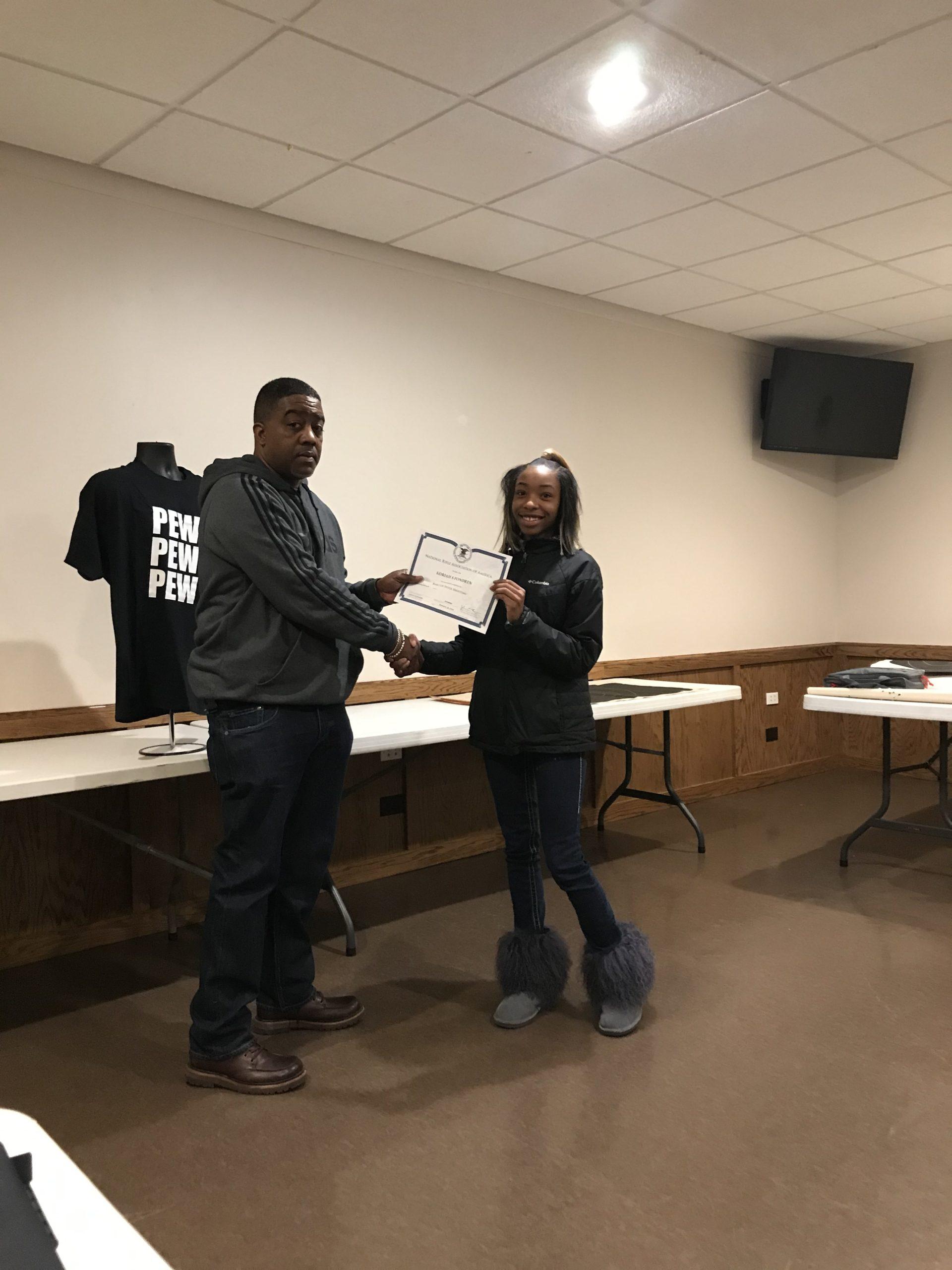 Woman Receiving CPL Class Certificate | Pew Pew Guru